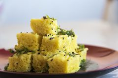 Gujarati Khaman Dhokla or Steamed Gram Flour Snack - Indian Cuisine. Khaman is a food common in the Gujarat state of India made from soaked and freshly ground royalty free stock image