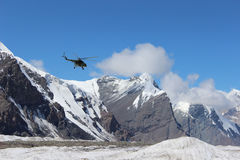 Soviet helicopter with climbers landing at Khan Tengri and Pobeda Peak base camp (Kyrgyzstan ) Stock Photos