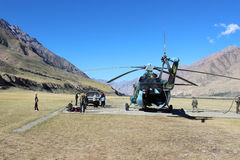 Soviet helicopter with climbers landing at Maida Adyr (Kyrgyzstan ) Royalty Free Stock Photo