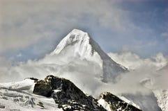 Khan Tengri peak. (7010m) in Central Tien Shan in clouds Royalty Free Stock Photos