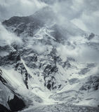 Khan Tengri peak a winter storm. 7010m. Khan Tengri norh face from Engilchek glacier in a winter storm Stock Images