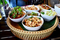 Khan tok or Khantoke dinners are a northern tradition thailand. With Northern Thai sausage and Green chilli dip with boiled vegetables Royalty Free Stock Photos