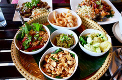 Khan tok or Khantoke dinners are a northern tradition thailand. With Northern Thai sausage and Green chilli dip with boiled vegetables Stock Photos