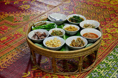 Khan tok or Khantoke dinners are a northern tradition thailand. With Northern Thai sausage and Green chilli dip with boiled vegetables Stock Images