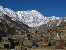 Khangsar and snow capped Tilicho Peak Stock Photo