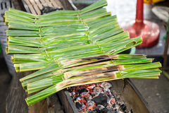 Khanom jaak. Nipa palm dessert, Thai sweetmeat made of flour, coconut and sugar, wrapped in leaves and grilled Stock Images