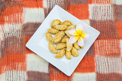 Khanom Pun Klib. Or Deep fried stuffed miced Chicken wrapped in Rice Flour Stock Photography