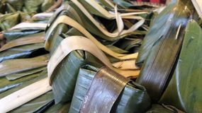 Khanom Sod-Sai Steamed Flour with Coconut Filling wrap in banana leaves Stock Photo