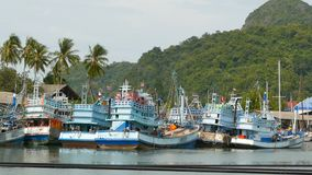 Khanom, Thailand - September 21, 2018. Rusty boats at coast. Old rusty ships parked at port in Fisherman city. Fishing. Squid industry. Traditional Asia stock video