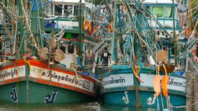Khanom, Thailand - September 21, 2018. Rusty boats at coast. Old rusty ships parked at port in Fisherman city. Fishing. Squid industry. Traditional Asia stock footage