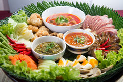 Khantoke. Khantoke dinners have long been a popular tourist attr Stock Photos