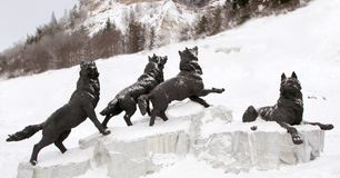 Pack of wolves sculpture , Archeopark,Khanty - Mansiysk, Russia Located at the foot of glacial hill, Archeopark shows lifelike sta. Khanty - Mansiysk,Russia Royalty Free Stock Image