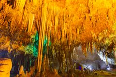 Khao bin cave of Thailand, inside cave view of multiple small slender stalactites on the ceiling of a dark cave. And a bright orange, Thailand stock photos
