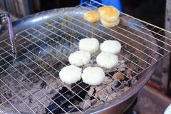 Khao Jee or grilled sticky rice with egg Stock Image