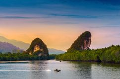 Khao kha nab nam at Krabi Thailand. The famous tourist attraction in southern of thailand. Twin mountains have rivers through the. Middle of the evening Royalty Free Stock Photo