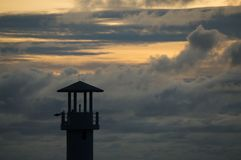 Khao Lak Light Beacon. Light beacon with dramatic clouds in the background Stock Photo