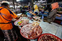 Khao Lak, Thailand - February 22, 2016:  Unknown woman buying fr. Esh chicken meat from local merchant on market. Thai cuisine is renowned for its tasty food Stock Photo