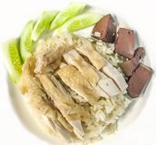 Khao Man Kai or Kao Man Gai Hainanese chicken rice, steamed chicken and white rice. Components: Khao Man is cooked rice in an oily or coconut sauce, Kai is Royalty Free Stock Photo