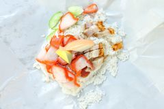 Khao Moo Daeng  rice with roasted red pork on paper packed, Popular Thai food Stock Photo