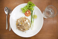 Khao phat pu, Fried rice with crabmeat silverware water. Thai food lunchtime dish of Thai rice, Fried rice with crabmeat and mix onion, egg, tomato, and scallion Royalty Free Stock Photo