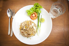 Khao phat pu, Fried rice with crabmeat silverware water. Thai food lunchtime dish of Thai rice, Fried rice with crabmeat and mix onion, egg, tomato, and scallion Royalty Free Stock Photography