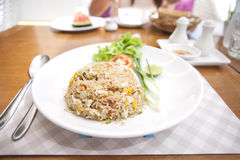 Khao phat pu, Fried rice with crabmeat silverware water. Thai food lunchtime dish of Thai rice, Fried rice with crabmeat and mix onion, egg, tomato, and Royalty Free Stock Image
