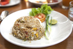 Khao phat pu, Fried rice with crabmeat. Thai food lunchtime dish of Thai rice, Fried rice with crabmeat and mix onion, egg, tomato, and  scallion Stock Photo