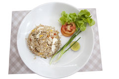 Khao phat pu, Fried rice with crabmeat. Thai food lunchtime dish of Thai rice, Fried rice with crabmeat and mix onion, egg, tomato, and scallion on white Stock Photo
