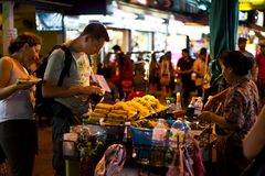 Foreigner buying Pad Thai Stock Images