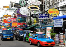 Khao San Road,Bangkok,Thailand. A variety of signs for shops, restaurants,hub,spas, and internet cafes hang out of buildings. famous Khao San Road in Bangkok Stock Image