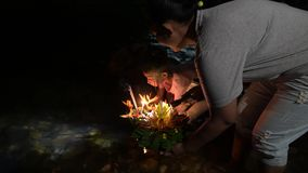Khao Sok - November 22: Loy Krathong festival, Thai people buy flowers and candle to light and float on water to. Celebrate the Loy Krathong festival on stock footage