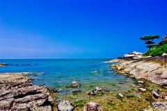 Khao takiab. The green sea, the green tree, the sky is blue Stock Photography