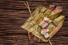 Khao Tom Mat - Thai dessert - Sticky Rice, Banana and Black Beans Wrapped in Banana lea Stock Photo