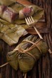 Khao Tom Mat - Thai dessert - Sticky Rice, Banana and Black Beans Wrapped in Banana leaf Stock Image