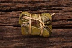Khao Tom Mat - Thai dessert - Sticky Rice, Banana and Black Beans Wrapped in Banana leaf Stock Images