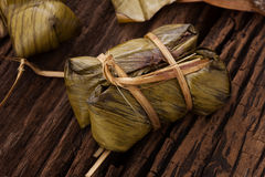 Khao Tom Mat - Thai dessert - Sticky Rice, Banana and Black Beans Wrapped in Banana leaf Royalty Free Stock Photo
