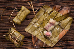 Khao Tom Mat - Thai dessert - Sticky Rice, Banana and Black Beans Wrapped in Banana leaf Stock Image