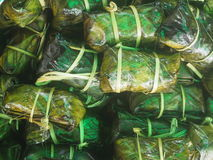 Khao tom. Thai dessert , a combination of glutinous or sticky rice, steamed seasoned and wrapped in banana leaves. It can be salty or sweet if it is filled with Stock Photography