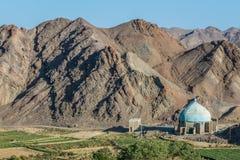 Kharanaq in Iran. Small mosque seen from abandoned mud brick village of Kharanaq in Iran Stock Image