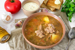 Kharcho is georgian soup with rice and meat served with bread Stock Image