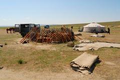 Mongolian men assemble yurt nomadic tent in steppe in Kharkhorin, Mongolia. KHARKHORIN, MONGOLIA - AUGUST 25, 2006: Unidentified Mongolian men assemble yurt royalty free stock image