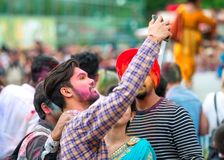 People celebrating Holi color festival in Kharkiv, Ukraine. KHARKIV,-MAY, 19: People celebrating Holi color festival. Indian festival of color in the park in Royalty Free Stock Photography