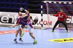 KHARKIV, UCRÂNIA - 22 DE SETEMBRO: Harmonia de liga dos campeões dos homens do EHF entre o motor Zaporozhye e HBC Nantes de HC Imagens de Stock