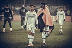KHARKIV UKRAINA - Februari 14, 2019: Jonathan de Guzman och Danny da Costa under UEFA Europa Leaguematchen mellan Shakhtar royaltyfria foton