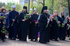 Kharkiv, Ukraine – 26 april, 2018: Moleben and laying flowers. Kharkiv, Ukraine - 26 april, 2018: Moleben and laying flowers at the monument to the royalty free stock photography