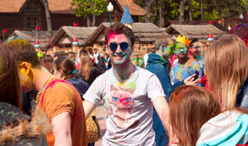 Kharkiv, Ukraine - April 24, 2016. Portrait of a painted guy among people at the Holi festival Stock Images