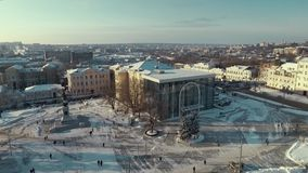 Kharkiv, Ukraine - Dec 13, 2016: Aerial of Constitution Square, History museum covered with snow. Sunny winter day stock footage