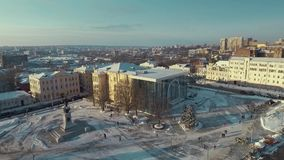 Kharkiv, Ukraine - Dec 13, 2016: Aerial of History museum, Constitution Square covered with snow. Sunny winter day stock footage