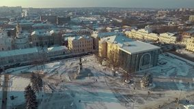 Kharkiv, Ukraine - Dec 13, 2016: Aerial of History museum, Constitution Square covered with snow. Sunny winter day stock video footage