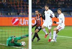 UEFA Champions League: Shakhtar Donetsk v Roma. KHARKIV, UKRAINE - FEBRUARY 21, 2018: AS Roma players white shirts attack the Shakhtar Donetsk net during their Stock Photos